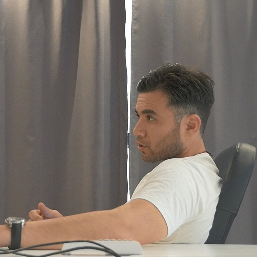 Giannos in a meeting