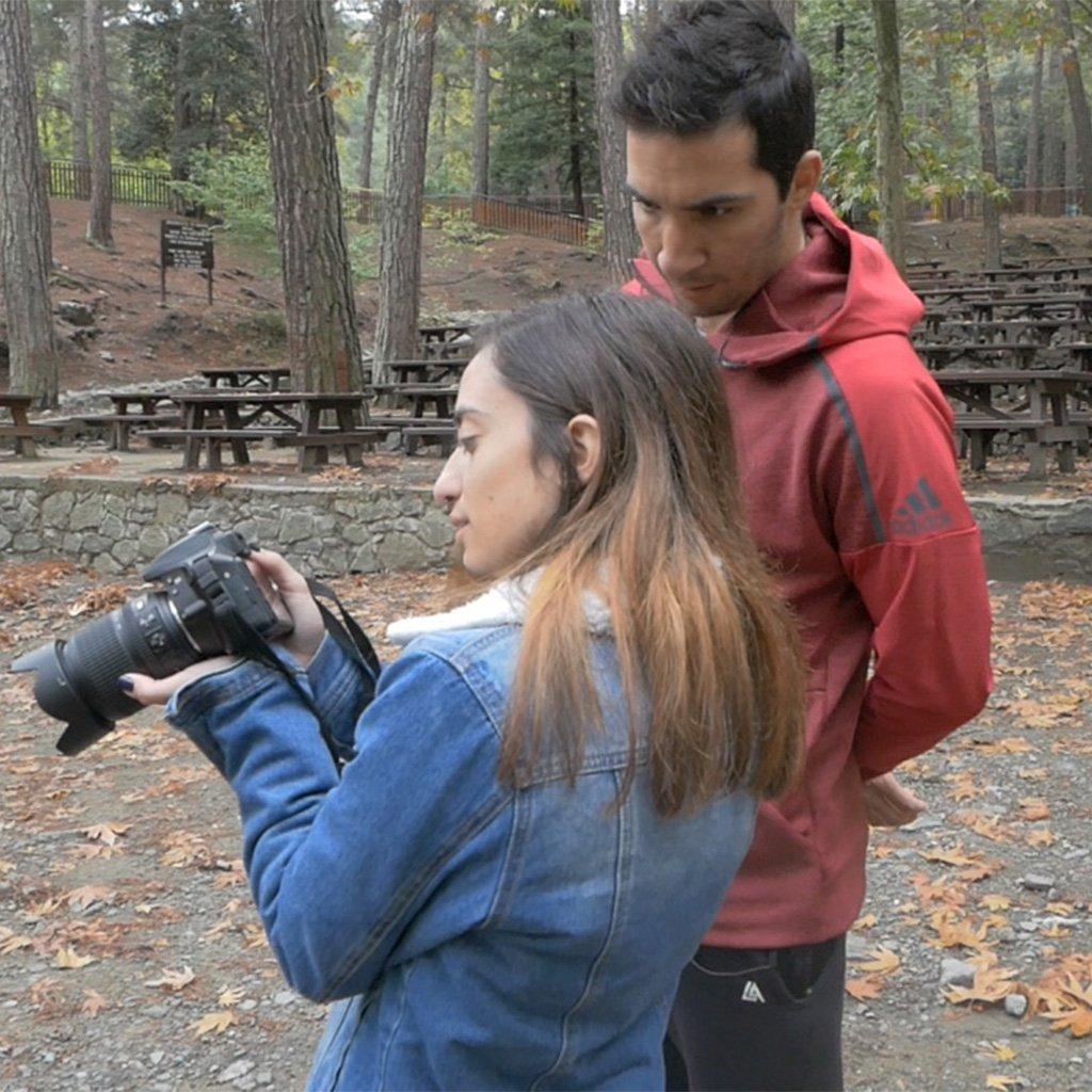 Panayiotis and Maria looking at camera